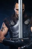 picture of longsword  - Young man has some dangerous hobby - JPG