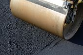 picture of scrap-iron  - Iron Road Roller leveling fresh asphalt pavement - JPG