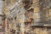 stock photo of freemason  - Weathered and ruined outdoor wall of 15th century Rosslyn Chapel in Scotland before the restoration - JPG