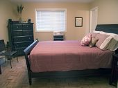 stock photo of safe haven  - master bedroom with queen bed - JPG