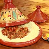 stock photo of tagine  - terracoota tagine with wheat semolina and meatballs - JPG