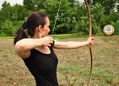 picture of longbow  - Young women training with the bow and green arrow - JPG