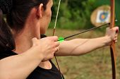 picture of longbow  - Young women training with the bow and arow