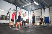 picture of gym workout  - Group training with personal trainer and instructor at a fitness center - JPG