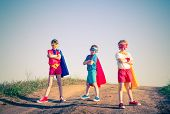 image of friendship  - kids acting like a superhero retro vintage instagram filter - JPG