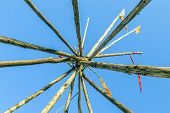 picture of tipi  - Tipee stakes and ribbons shown against a blue sky - JPG