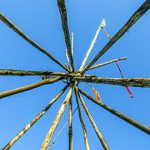 image of tipi  - Tipee stakes and ribbons shown against a blue sky - JPG