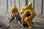 image of respiration  - Man in chemical protection suit carrying out the decontamination area