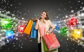 image of glow  - happy shopping woman surrounded by glow icons of e - JPG