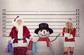 stock photo of mug shot  - Santa carries some Christmas bags against mug shot background - JPG
