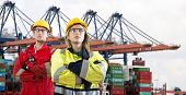 picture of container ship  - Two proud looking dockers - JPG