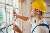 pic of spirit  - Construction worker using spirit level in a new house - JPG