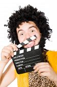 foto of hirsutes  - Cave man with movie board isolated on white - JPG