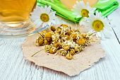 image of chamomile  - Dried chamomile flowers on paper - JPG