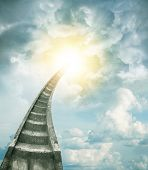 foto of stairway to heaven  - Stairway leading up to bright light  - JPG