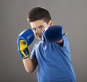 stock photo of pre-adolescent child  - Child ready to swing left hook  - JPG