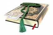 image of quran  - Closed Quran with Pakistani currency before light background