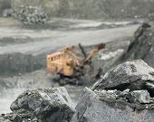 pic of asbestos  - Mineral asbestos on the background of the excavator in a quarry - JPG