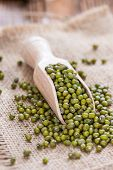 stock photo of mung beans  - Some Mung Beans on an old wooden table  - JPG