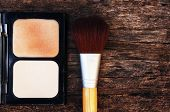 picture of face-powder  - cosmetics such as lipstick or powder applied to the face used to enhance or alter the appearance - JPG