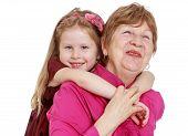 pic of granddaughters  - Charming granddaughter hugging beloved grandmother - JPG