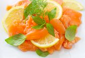 pic of redfish  - salad on salmon on the white plate - JPG