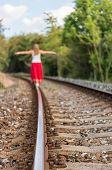 picture of girl walking away  - Girl Walking On Rails in the Czech Republic - JPG