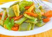 picture of grated radish  - fried vegetables on plate and on a table - JPG