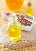 pic of flax seed oil  - flax seed in bowl and on a table - JPG