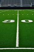 stock photo of bleachers  - 30 Yard Line on American Football Field with Bleachers - JPG