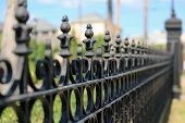 picture of wrought iron  - Very narrow dept of field focus on the iron black fence - JPG