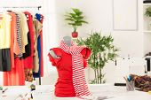 foto of dress mannequin  - Dress on mannequin in fashion designer office - JPG