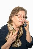 foto of retirement  - Pensioner woman with glasses calling phone on white background - JPG