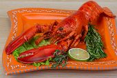 stock photo of lobster tail  - Red boiled lobster with thyme and rosemary - JPG