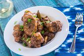 stock photo of thighs  - Chicken thighs marinated and cooked in adobo sauce - JPG