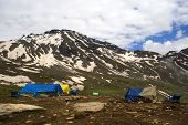 stock photo of himachal pradesh  - Tents in front of the snowy mountain picks at Rothang pass is the highest point - JPG