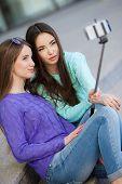 foto of two women taking cell phone  - Beautiful girls - JPG
