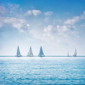 stock photo of sailing vessels  - Sailing boat yacht or sailboat group regatta race on sea or ocean water - JPG