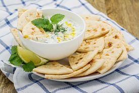 stock photo of fresh slice bread  - Refreshing sauce based on Greek yogurt - JPG
