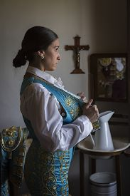 foto of bullfighting  - Woman Bullfighter waiting in hotel room before going to the bullring in Seville - JPG