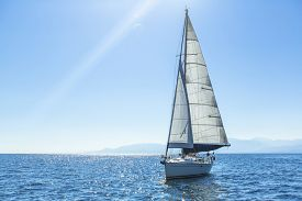 picture of yacht  - Sailing ship yachts with white sails in the open Sea - JPG