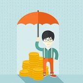image of money  - A chinese businessman standing holding umbrella protecting his money to investments - JPG