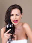 picture of red wine  - Portrait of beautiful woman she holding glass of red wine - JPG