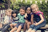 Group of Diverse Kids Sitting Together poster
