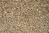 stock photo of fieldstone-wall  - the detail of a wall made of stones - JPG