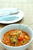 Prawn masala curry serves with chives on bamboo mat