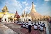 YANGON, MYANMAR - JAN 28: Buddhist devotee pray at the full moon festival, Shwedagon Pagoda, January