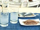 image of ouzo  - Ouzo and misc seafood near the beach - JPG