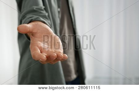 Man Giving Hand To Somebody