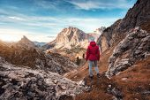 Young Woman On The Trail Looking On High Mountain Peak At Sunset In Dolomites, Italy. Autumn Landsca poster
